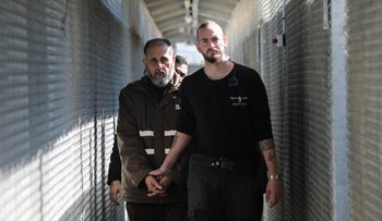 Samer Arbid is pictured on the left at Ofer Prison, February 2020.