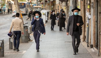 Ultra-Orthodox men wearing masks walk in Jerusalem, January 17, 2021. The subjects have no connection to the content of the article.