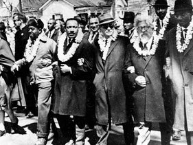 Rabbi Abraham Joshua Heschel (second from right) in the March 21, 1965 civil rights march from Selma to Montgomery. Martin Luther King Jr. is fourth from right.