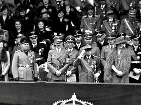 This 1938 file photo, which was taken during the official visit of Adolf Hitler to Rome, shows among others Italian Duce Benito Mussolini, Adolf Hitler and king Vittorio Emanuele III.
