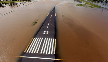 Floodwaters spreading across the runway of Rockhampton Airport in 2011.