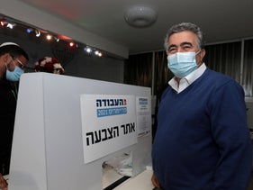 Former Labor Chairman Amir Peretz votes at the party's primary election in Sderot, January 24, 2021.