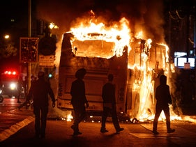 Bus in Bnei Brak that was set on fire by a Haredi mob protesting police enforcement of Israel's COVID lockdown restrictions, Jan. 24, 2021