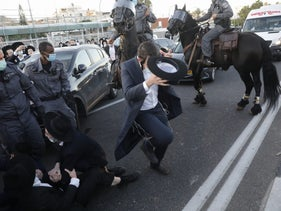 Members of the Ultra-Orthodox community rioting in Bnei Brak as police attempt to enforce COVID restrictions, 2021.