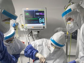 Medical staff works to put a patient on a ventilator at Beilinson Hospital, January 21, 2021.