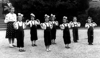 Girls from the Zabrze children's home, exercising while on vacation