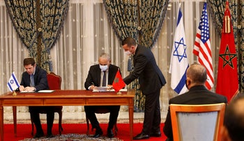 Morocco and Israel sign agreements at the guest house next to the royal palace in Rabat, Morocco, Dec. 22, 2020.