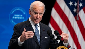President Joe Biden answers questions from reporters in the South Court Auditorium on the White House complex, in Washington, January 25, 2021.