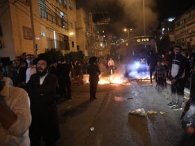 A protest attended by hundreds of members of the radical ultra-Orthodox Jerusalem faction against police enforcement of coronavirus restrictions, Bnei Brak, January 24, 2021.
