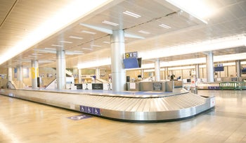 An empty baggage claim area at Ben-Gurion International Airport early in the coronavirus pandemic.