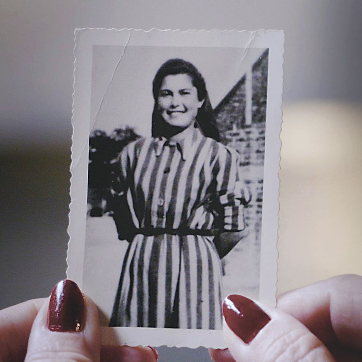 Helena Citron in Auschwitz. She is seen smiling, well-fed, standing straight and radiant in the photo, atypical for prisoners at the death camp.