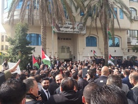 Palestinian lawyers protest against the issuance of new Presidential Decrees limiting the independence of the judiciary, Ramallah, January 27, 2021.