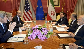 Then-Secretary of State Kerry, Secretary of Energy Ernest Moniz and Robert Malley wait to start a meeting with Iranian officials at the Beau Rivage Palace Hotel in Lausanne, March 29, 2015.