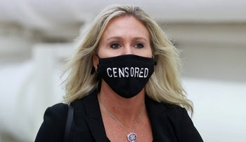"""U.S. Representative Marjorie Taylor Greene (R-GA) wears a mask reading """"Censored"""" as she walks to the House floor during debate on the second impeachment of President Donald Trump at the U.S. Capitol in Washington"""