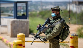 A soldier on guard duty at Gush Etzion junction, April 2020.