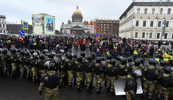 Law enforcement officers block protesters during a rally in support of jailed opposition leader Alexei Navalny in Saint Petersburg on January 31, 2021