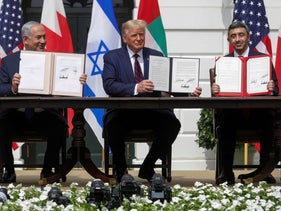 Prime Minister Benjamin Netanyahu, U.S. President Donald Trump and UAE Foreign Minister Abdullah bin Zayed displaying their copies of signed agreements as they participate in the signing ceremony of the Abraham Accords at the White House, September 15, 2020.