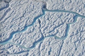 Water flowing on in channels on the Greenland ice