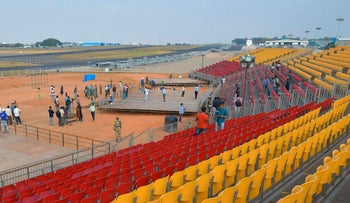 Workers setup the inaugural area for the 13th edition of the Aero India Show 2021 at the Yelahanka Airforce Station in Bangalore