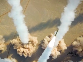 Iran's paramilitary Revolutionary Guard forces held a military exercise involving ballistic missiles and drones in the country's central desert