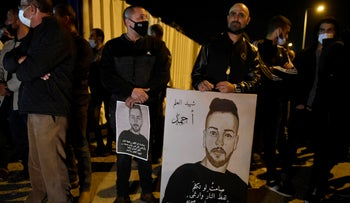 People protest after the funeral of nursing student Ahmed Hijazi, in Tamra on Tuesday night.