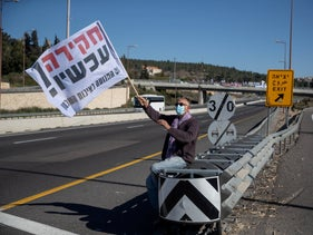 A demonstrator for the Movement for Quality Government on a highway last month.