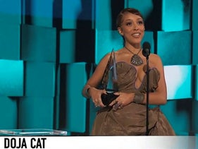 In this screen shot provided by ABC, Doja Cat accepts the award for new artist of the year at the American Music Awards at the Microsoft Theater in Los Angeles