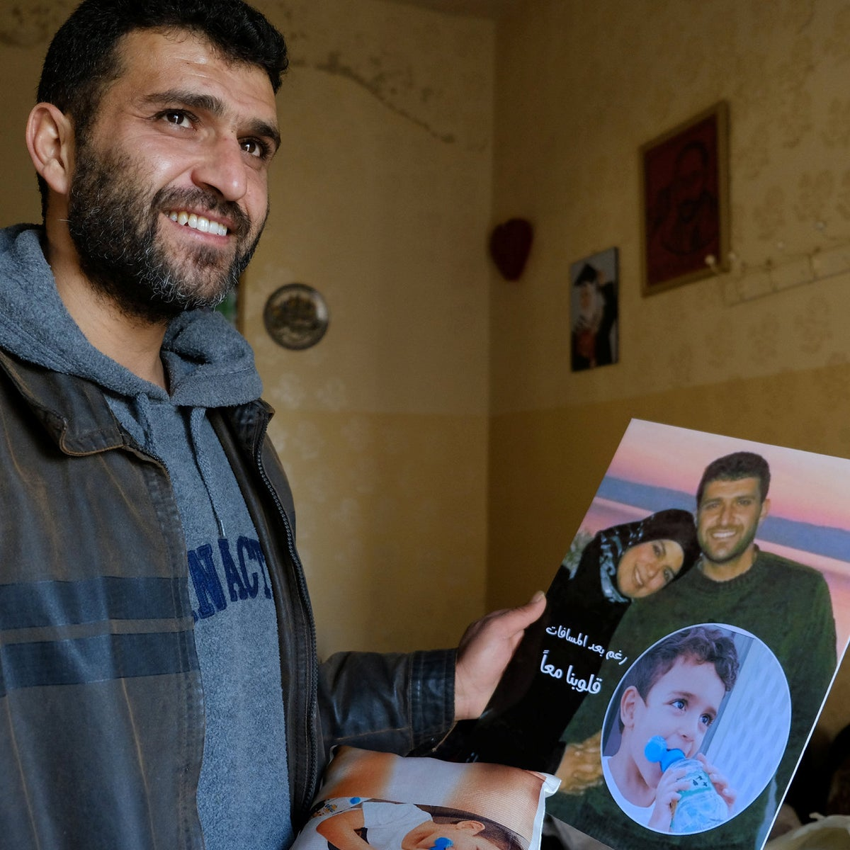 Mohammed Nazal with photos of his wife and son.