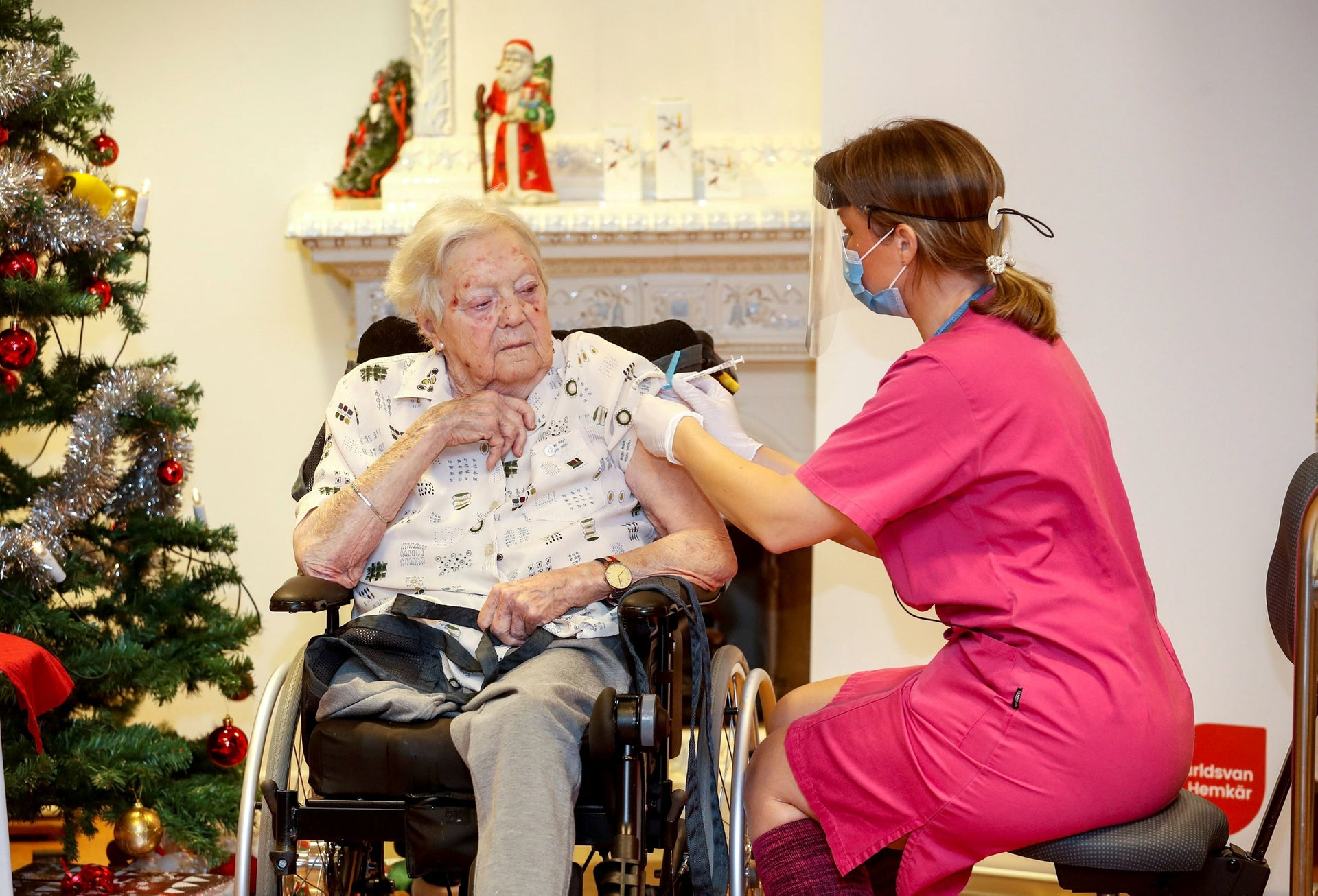 A nurse vaccinating a nursing home resident for the coronavirus in Mjölby, Sweden, in December.