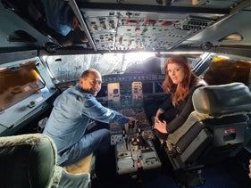 Rami Levy sits in the cockpit of an Israir plane