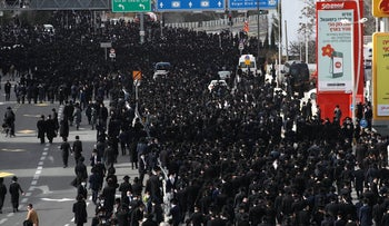 Thousands show up to attend the mass funeral of revered Rabbi Soloveitchik in Jerusalem, January 2021.