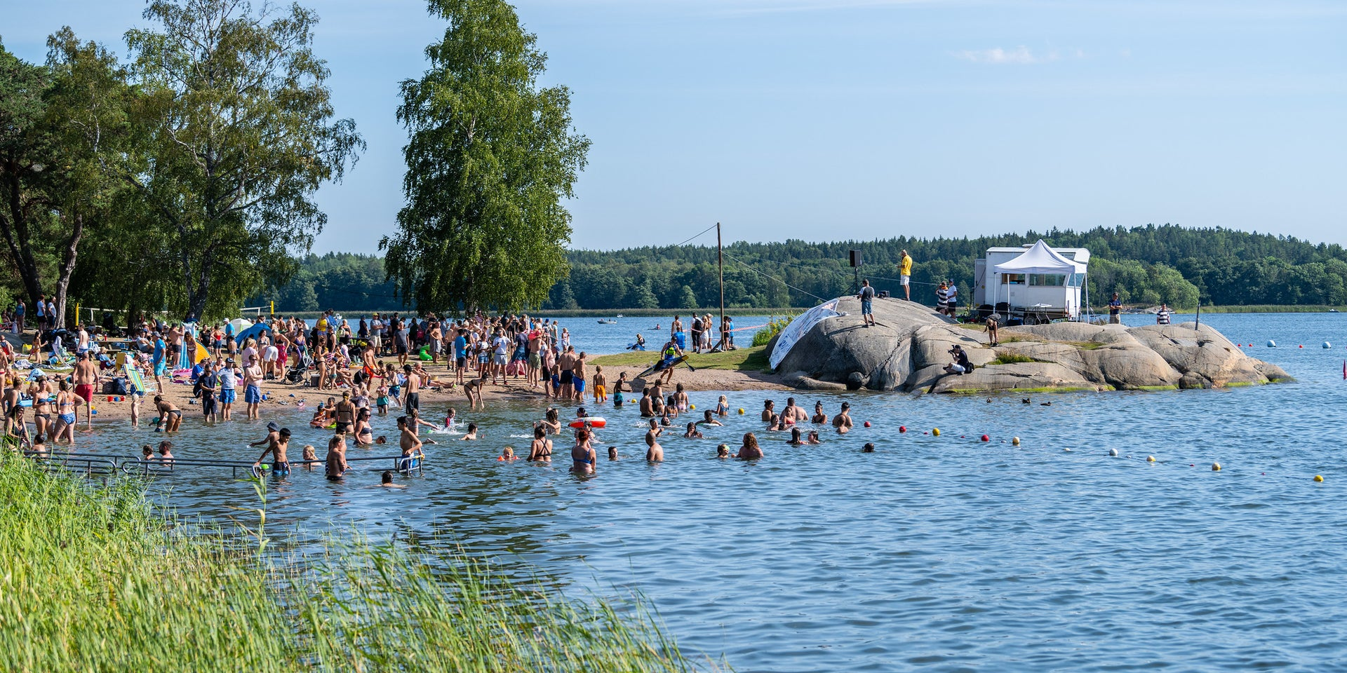 Locals enjoy the warmer weather in the municipality of Vaxholm, Stockholm, Sweden in the summer of 2020.
