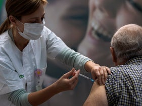 A man receives a coronavirus vaccine in Tel Aviv, developed as a result of discoveries by 2021 Wolf Prize winners in medicine.