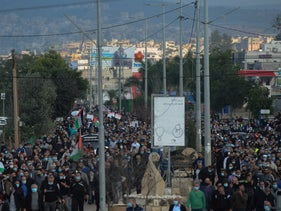 More than 10,000 people marched through the town of Tamra to demand action against rising violence in the Arab community today.