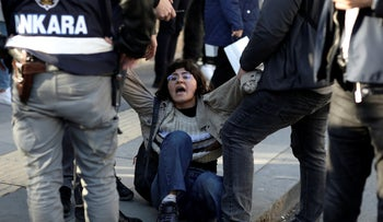 Riot police officers detain a student during a protest, in Ankara, Turkey, earlier this week