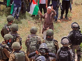 A Palestinian protester confronts Israeli forces during a demonstration against Israeli settlements on May 15, 2020 in al-Sawiya village, south of Nablus.