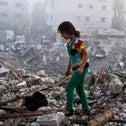 A girl combing the wreckage of her home in Shujaiyeh during the Gaza war.
