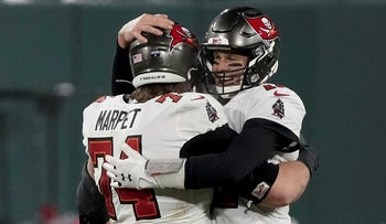 Tampa Bay Buccaneers quarterback Tom Brady (12) celebrates with Ali Marpet after winning the NFC championship NFL football game in Green Bay, Wis., Sunday
