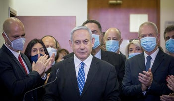 Netanyahu flanked by his closest allies on his first day in court in Jerusalem, in May 2020.