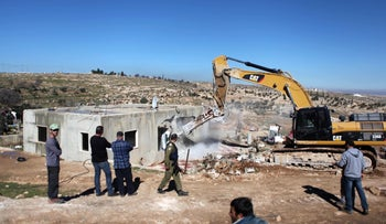 Demolition of Palestinian houses in the West Bank village of Yatta, in 2015