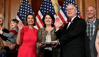 House Speaker Nancy Pelosi of Calif., poses during a ceremonial swearing-in with Rep. Ron Wright, R-Texas, fourth from right, on Capitol Hill in Washington