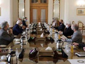 Iran's Foreign Minister Mohammad Javad Zarif (C-L) during his meeting with Martin Griffiths (C-R), special representative of the United Nations' secretary general for Yemen, in Tehran on February 8, 2021.