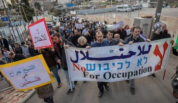 Activists protest against the eviction of Palestinian families from East Jerusalem's Sheikh Jarrah neighborhood, in 2019.
