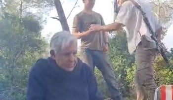 The confrontation between the father of the Israeli Arab family and the settlers.