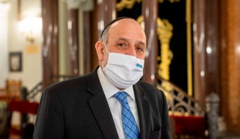 Chief Rabbi of Poland Michael Schudrich poses in a synagogue in Warsaw on January 15, 2021
