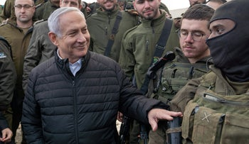 Netanyahu poses with IDF soldiers on the Israel-Lebanon border, last year.