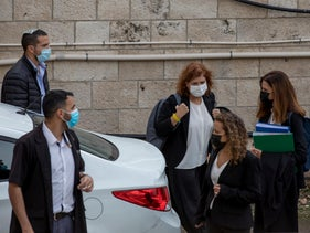 Liat Ben-Ari, chief prosecutor in Netanyahu's corruption trial, with the security detail assigned to her last year.