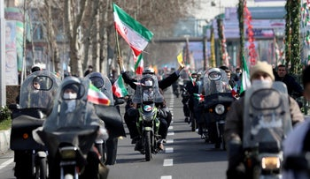 Iranians ride on motorcycles as they participate in the celebration of the 42nd anniversary of the Islamic Revolution in Tehran, Iran.