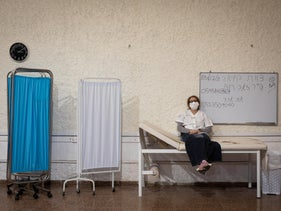 A medical worker relaxing between appointments at a coronavirus vaccination complex in Ramat Gan last week.