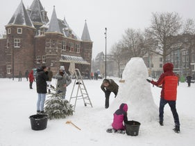 Making a snowman in the center of Amsterdam, this week.